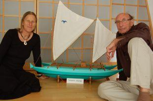 Falmouth Packet: Devoran residents Hanneke Boon and James Wharram next to a model of the canoe.