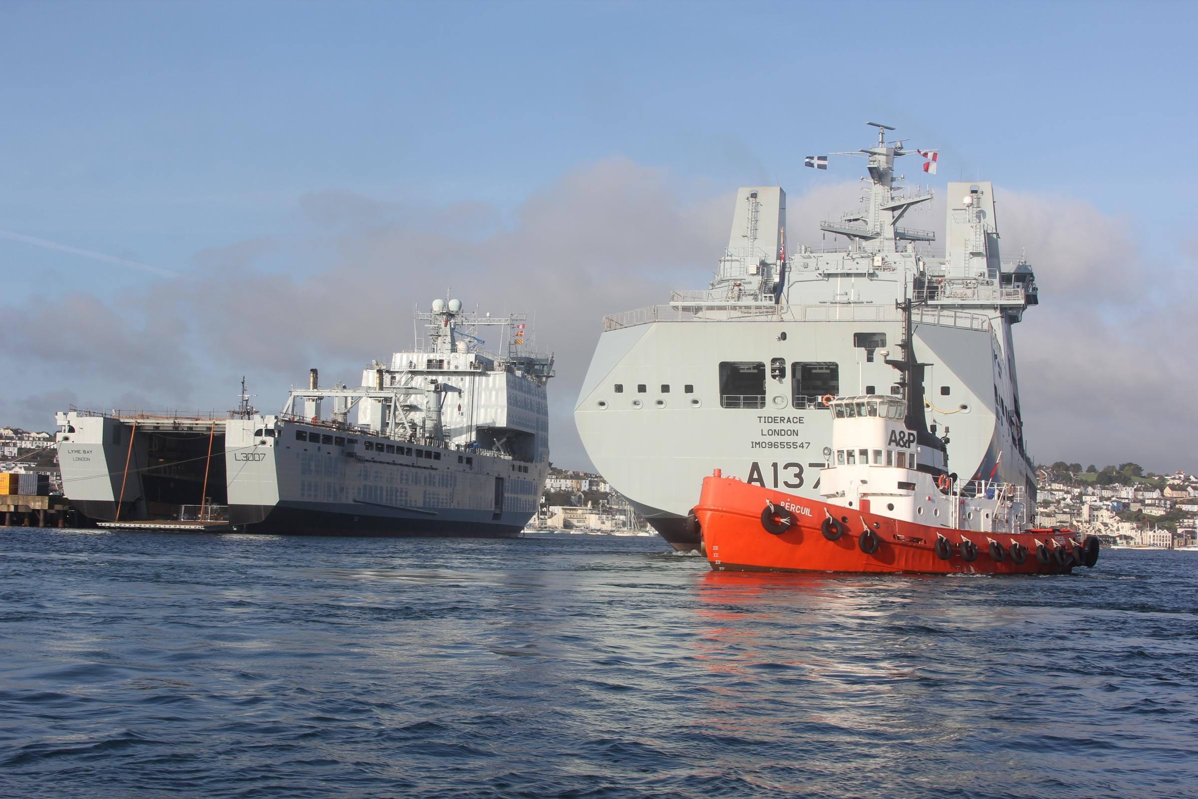 Aided by three tugs RFA Tiderace enters the inner harbour as she passes RFA Lyme Bay.  Photo: David Barnicoat