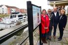 COAST PATH: Cllr Kathy Pearce, Cllr Mike Cresswell, Cllr David Hall and Rights of Way officer Sarah Littler at the Bridgwater Docks sign