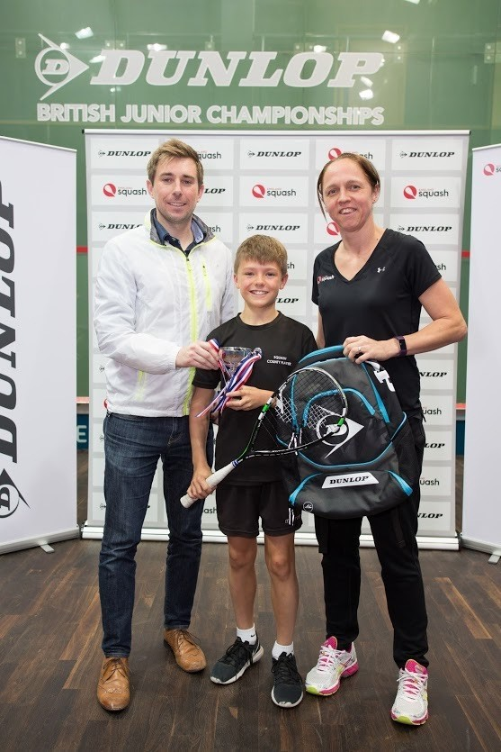 Jack Mahon receives his trophy after finishing third in the British Junior Championships in Manchester