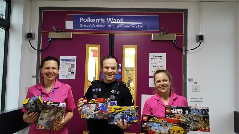PC Ross Waite with staff from Treliske's children's ward.