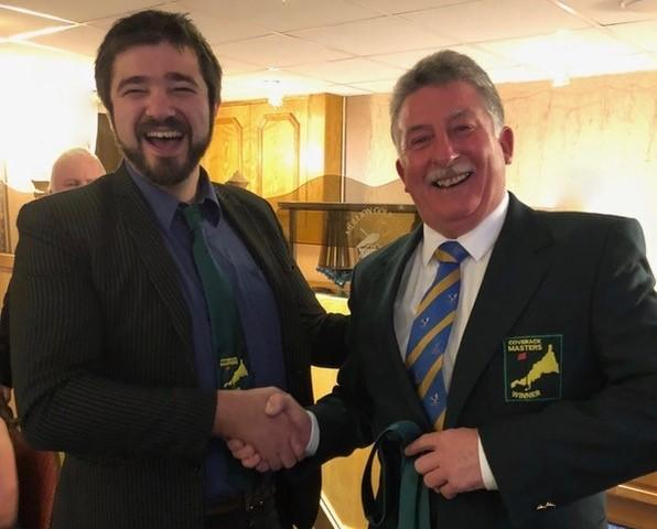 Ed Oxford presents Mullion Golf Club captain Wilf Hutchinson with the coveted Coverack Masters green jacket