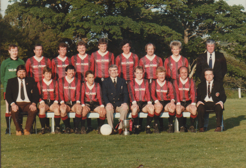 . Penryn Athletic Combination League (early 1980s). Back row: G Polhill, B Green, J Cornish, L Gilbert, R Riley, D Moses, D Foster, R Perrin, D Jenkin. Front row: P Young, R Nancholas, C Moses, P Kellow, J Chinn, S Mills, P Cardell, K Popperwell, M Young.