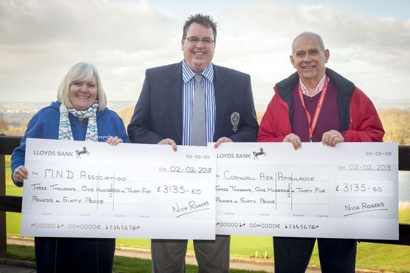 Nick Rogers presents cheques to the Cornwall Air Ambulance and the Motor Neurone Association