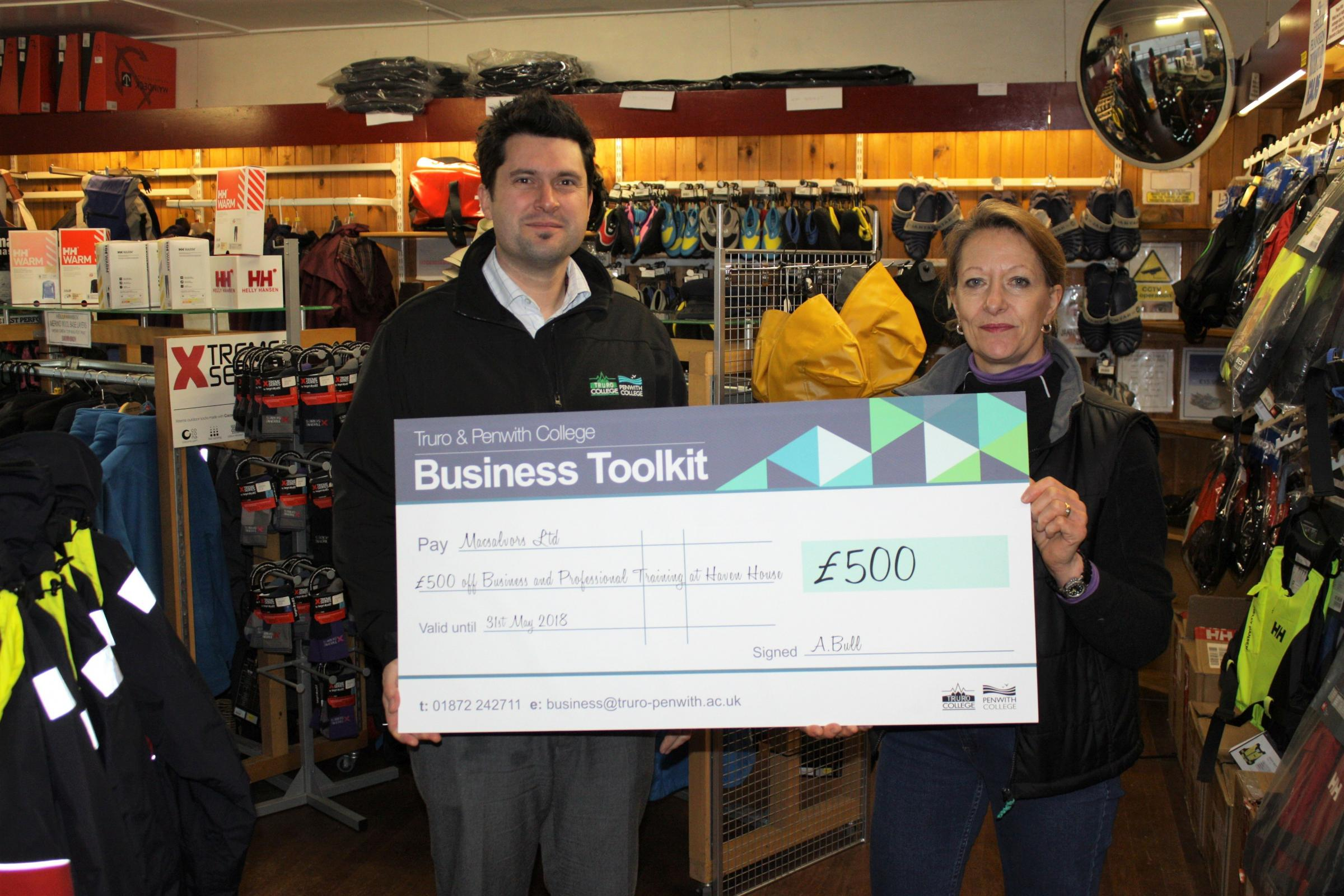 James Bemrose, BDA from the college handing over the £500 cheque to store manager Sally Bazley