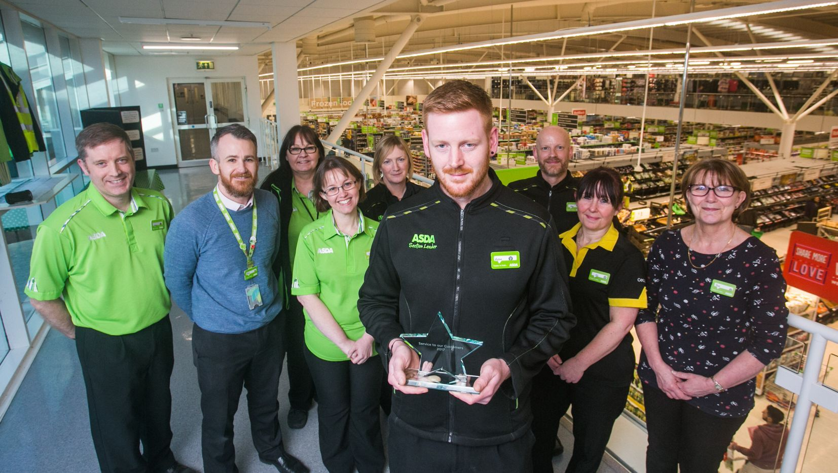 Award winning Aston Olver with some of his colleagues at Asda