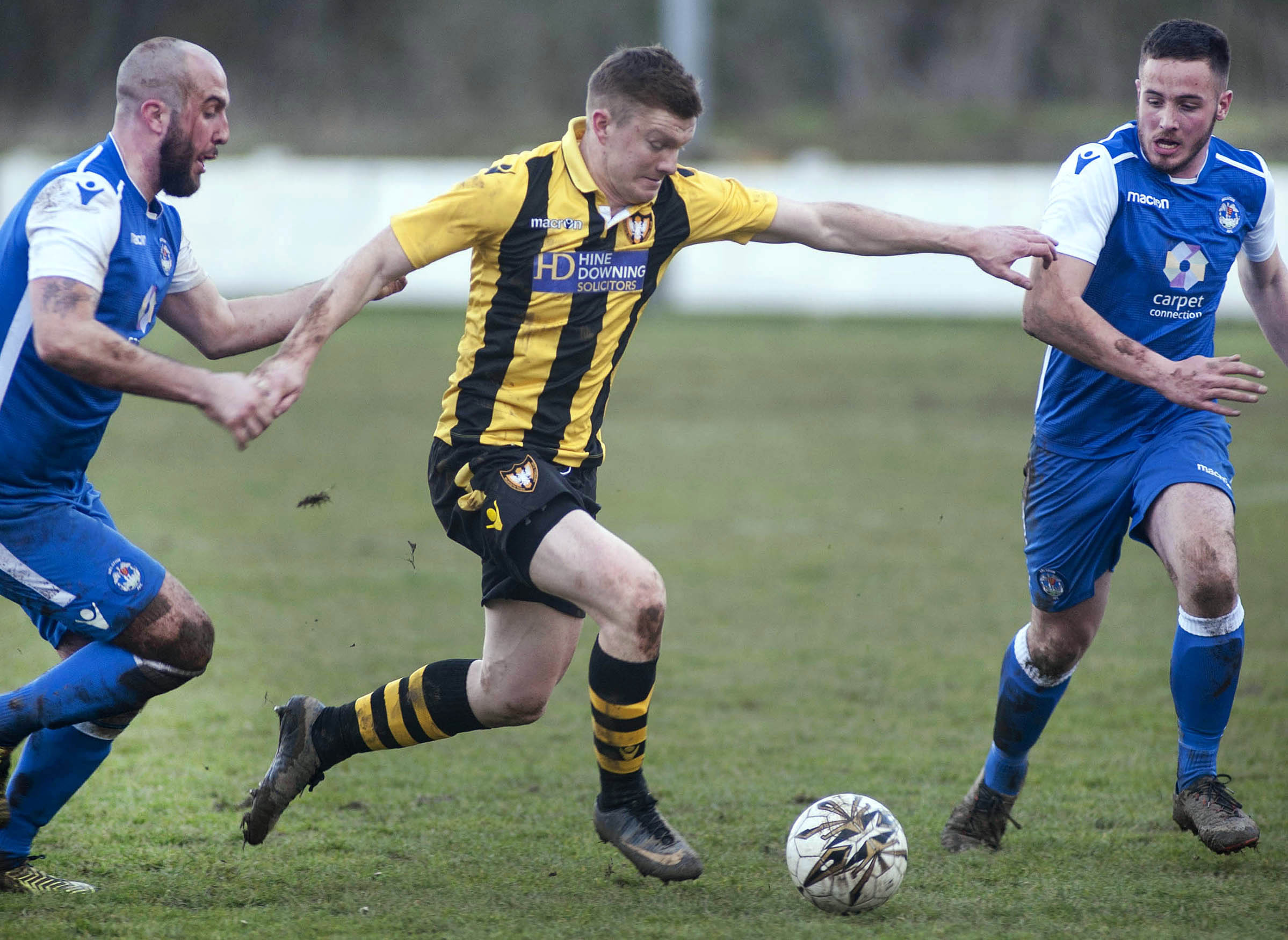 Action from the derby between Falmouth Town and Helston on Saturday