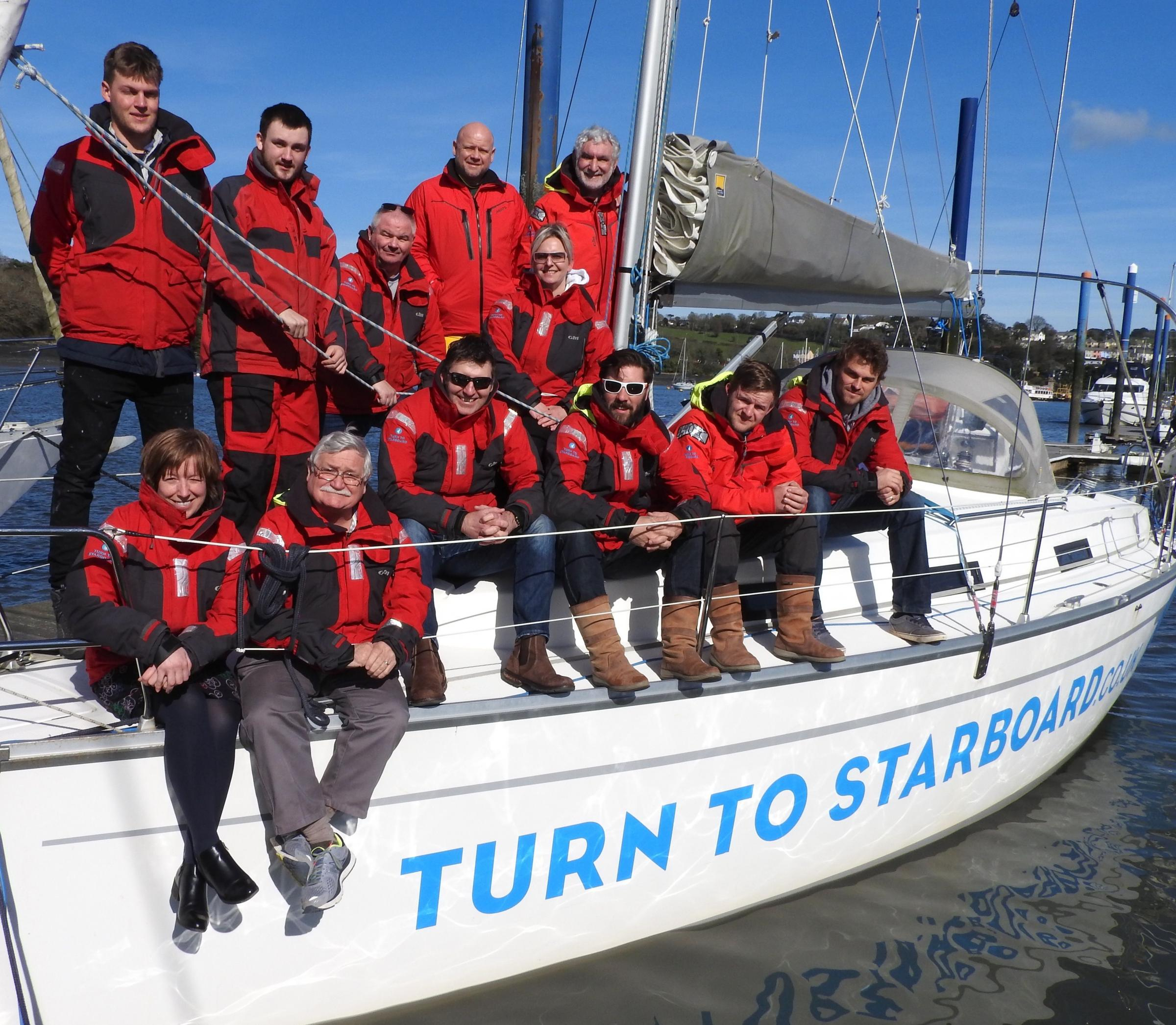 Staff and beneficiaries from Turn to Starboard get ready to race