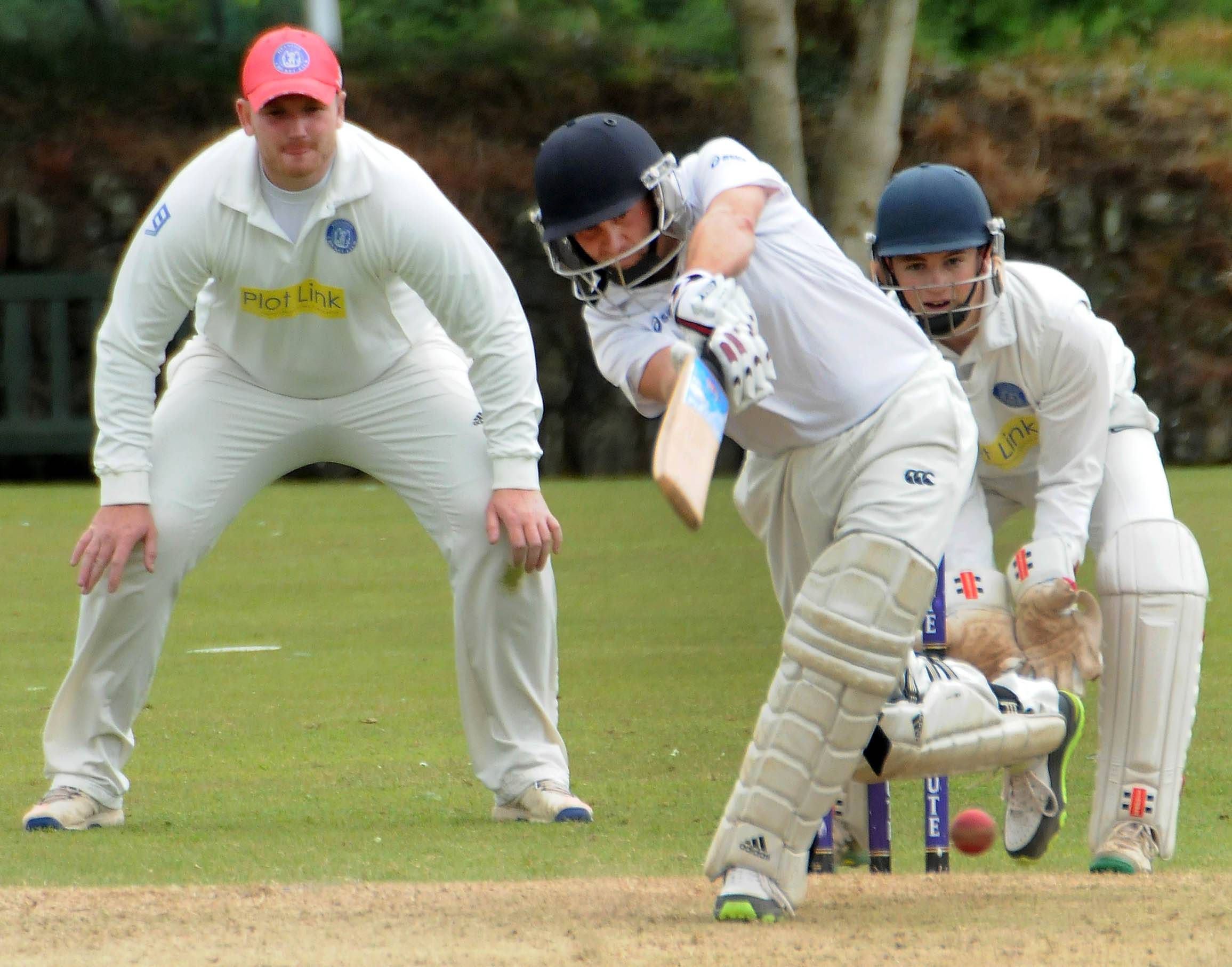 Helston wicket keeper Karl Leathley (right) and slip Steve Wiseman (left) field Beacon's Ben James (centre) during Helston's seven-wicket win on Saturday. Picture by Colin Higgs
