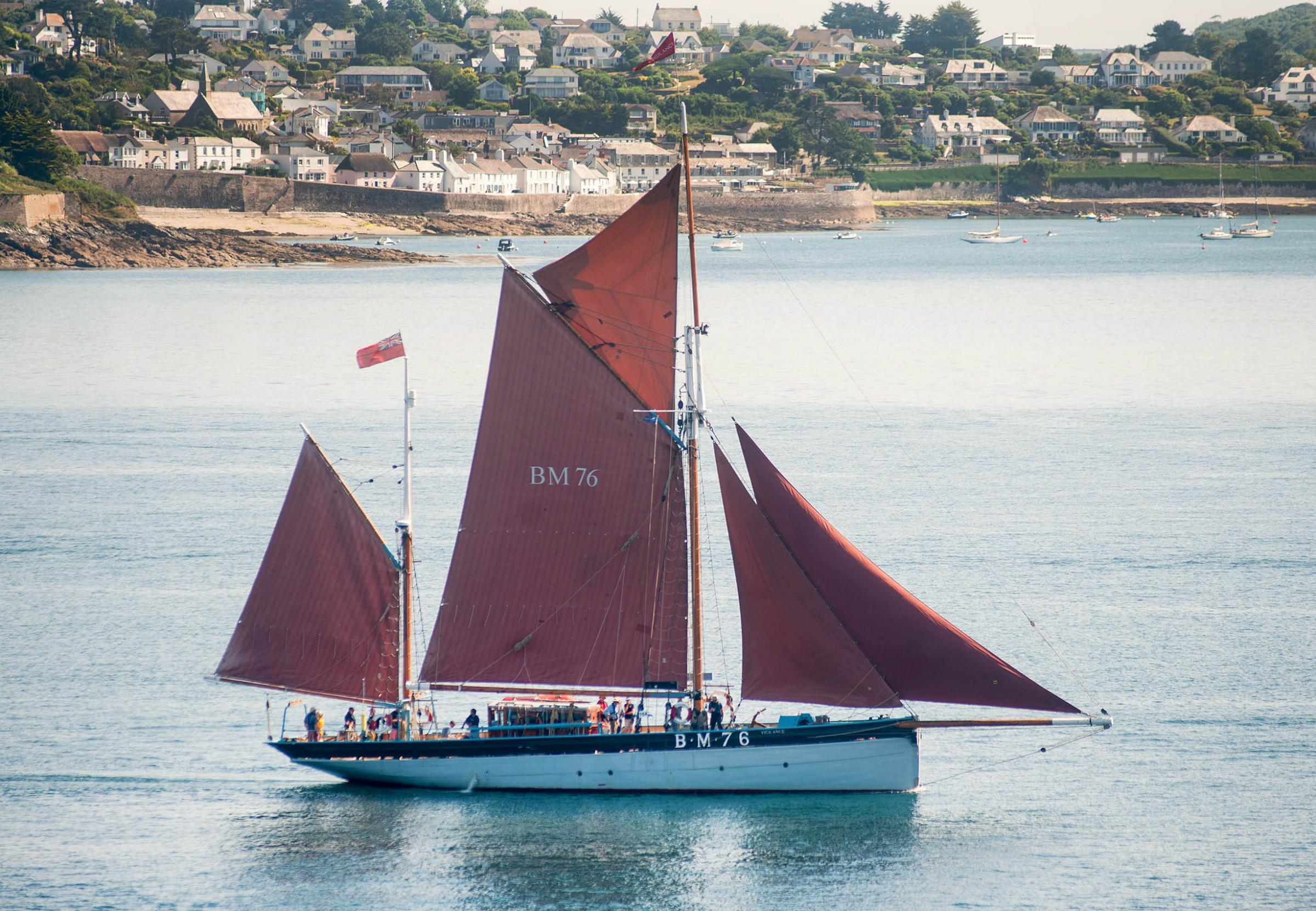 Falmouth Classics sail to the sound of sea shanties under beautiful blue skies