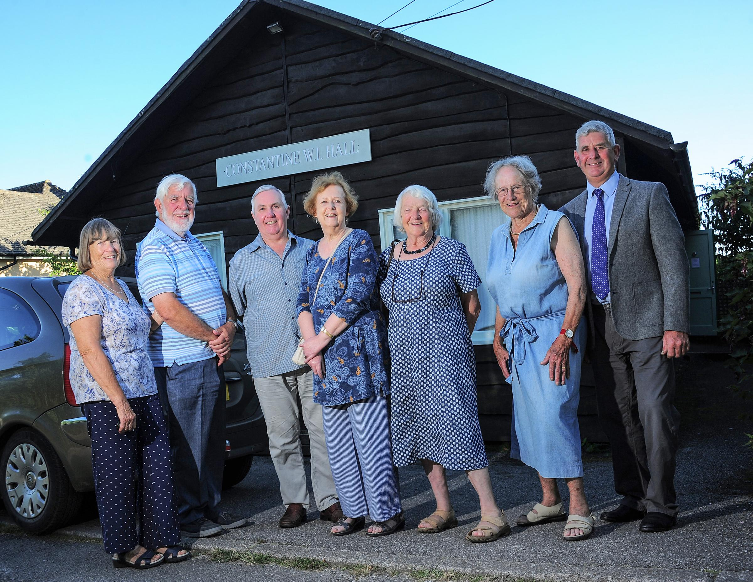 Representatives of some of the groups who use Constantine WI Hall celebrating the £2,000 donation from the IOSSC Community Fund.