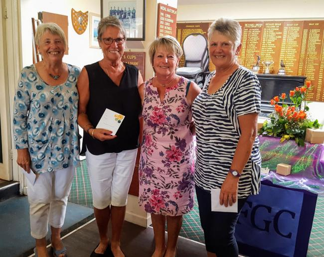 Left to right: Kath Kelly, Lyn Innes, Falmouth Lady Captain Rachael Curnow presenting the prizes and Alison Gessey from West Cornwall