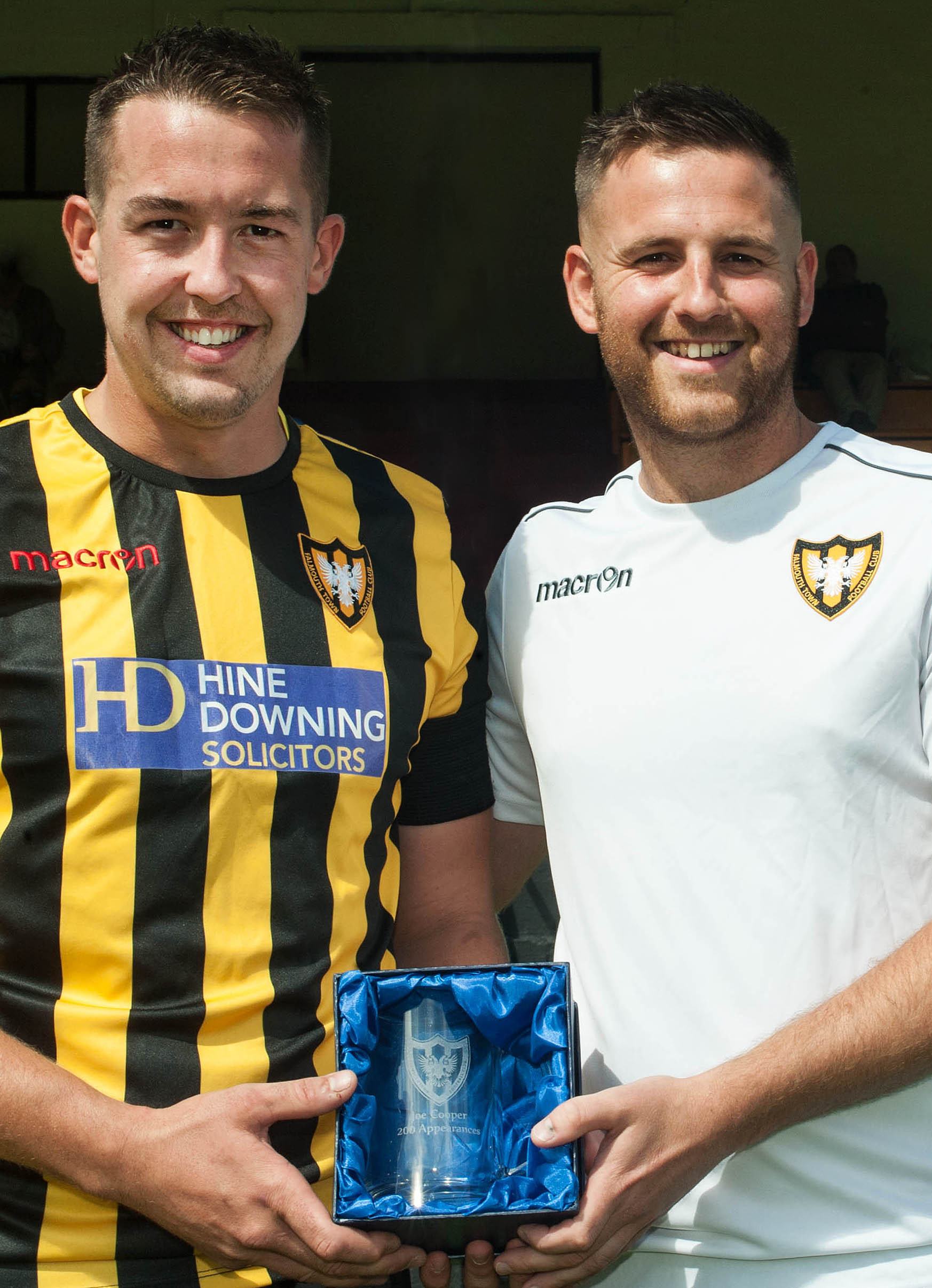 Falmouth Town manager Andrew Westgarth presents an engraved tankard to captain Joe Cooper to commemorate Joe's 200th appearance for the club on Saturday afternoon. Picture by Colin Higgs