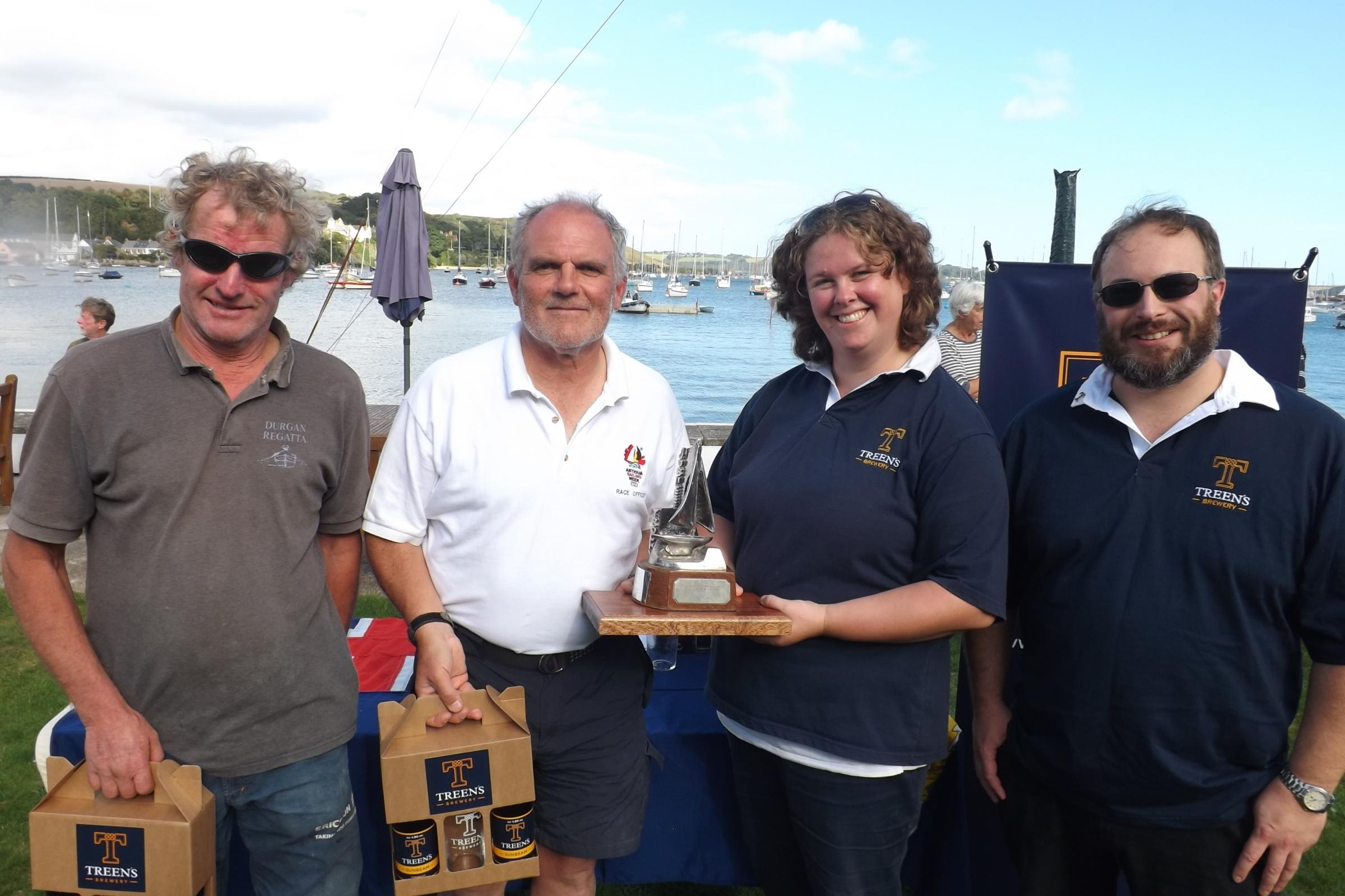 Tim Bailey (left) and Neil Andrew receive the championship trophy and prizes from Sarah and Simon Treen.