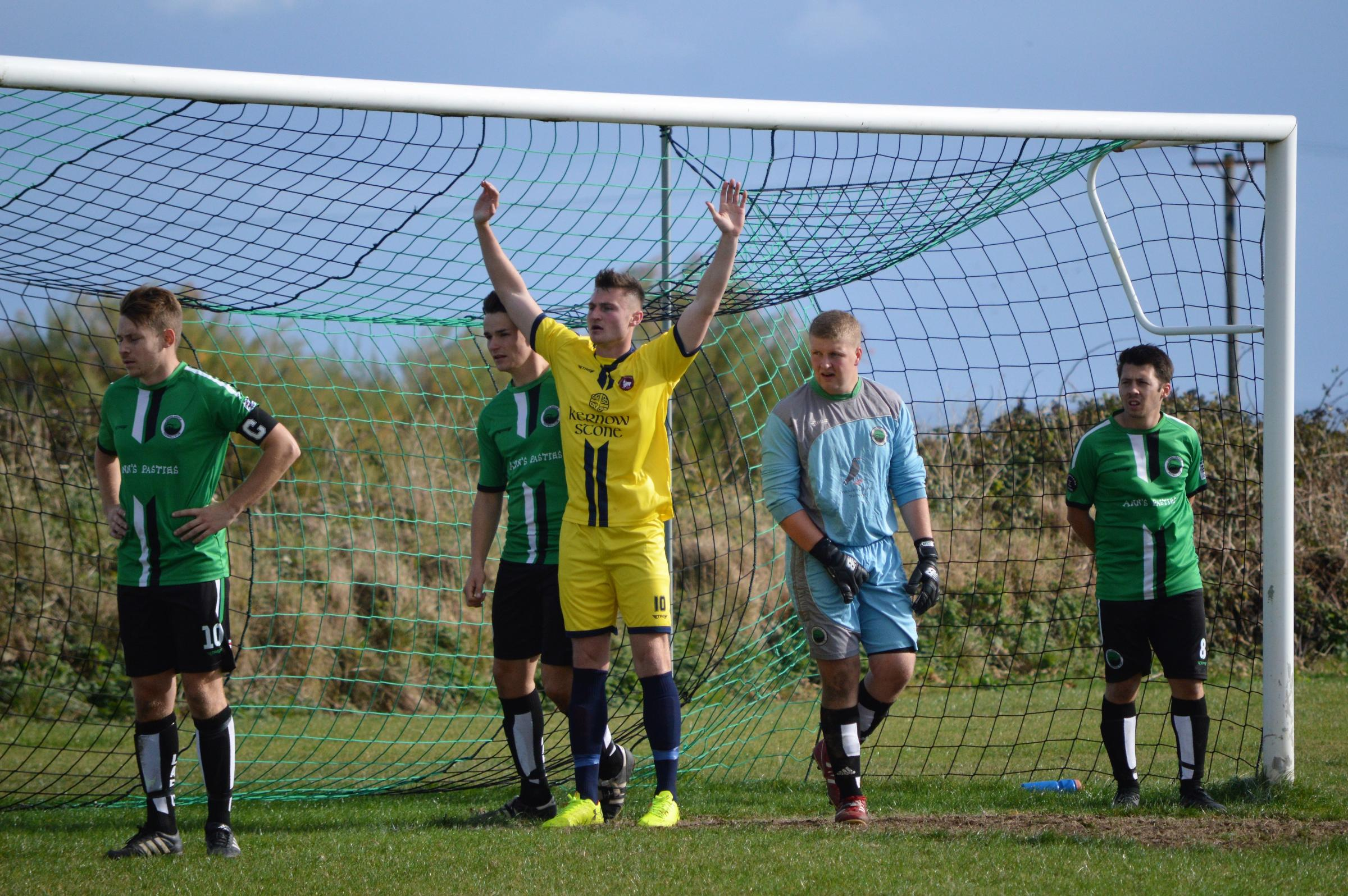 Wendron United striker Rory Jarvis (centre) scored his side's second goal in their 3-0 win at home to Plymouth Marjon in the SWPL Division 1 West on Saturday