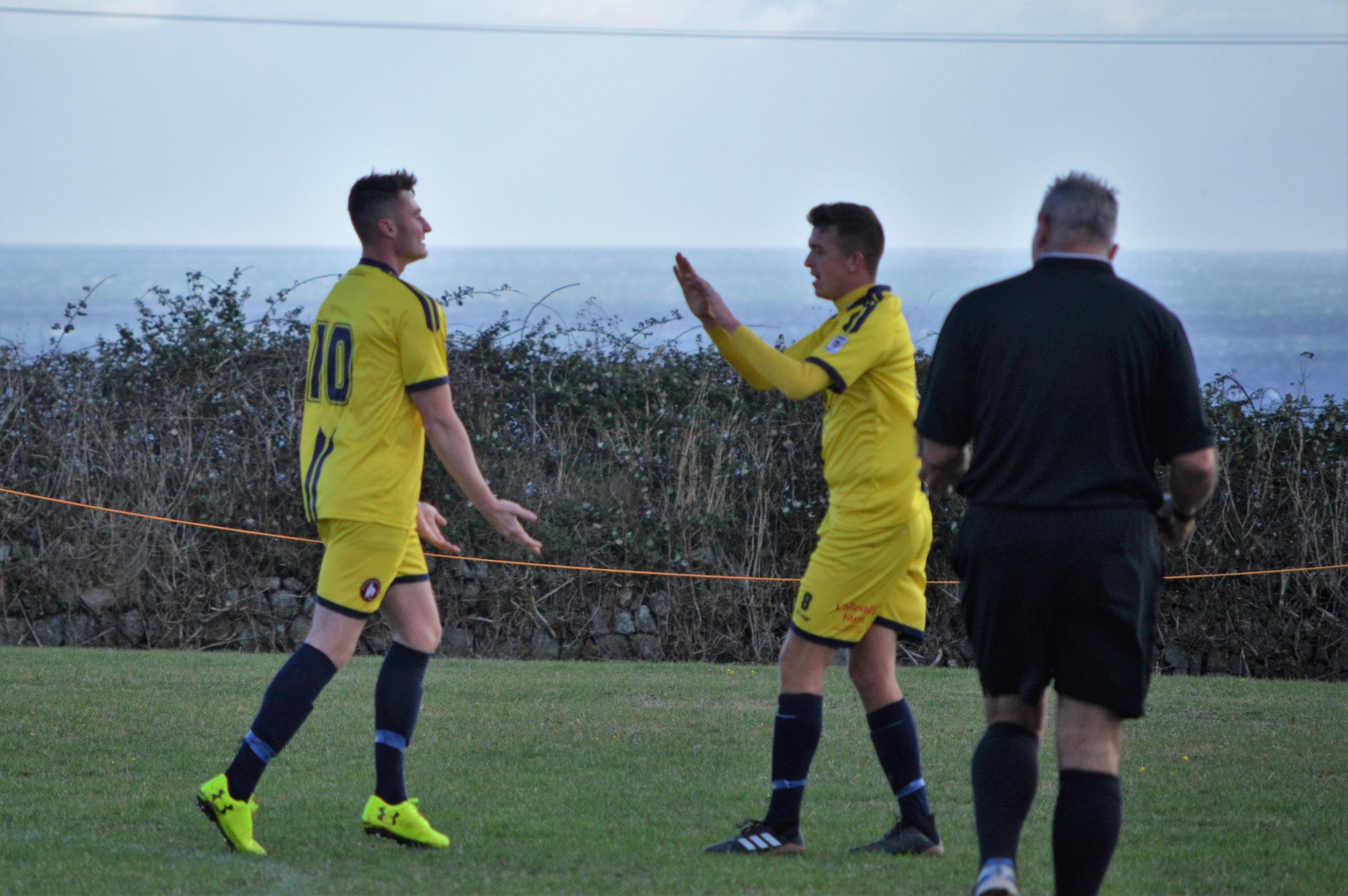 Wendron United striker Rory Jarvis (left) celebrates his second goal of his side's 2-0 win at Lizard Argyle in the Cornwall Senior Cup on Saturday