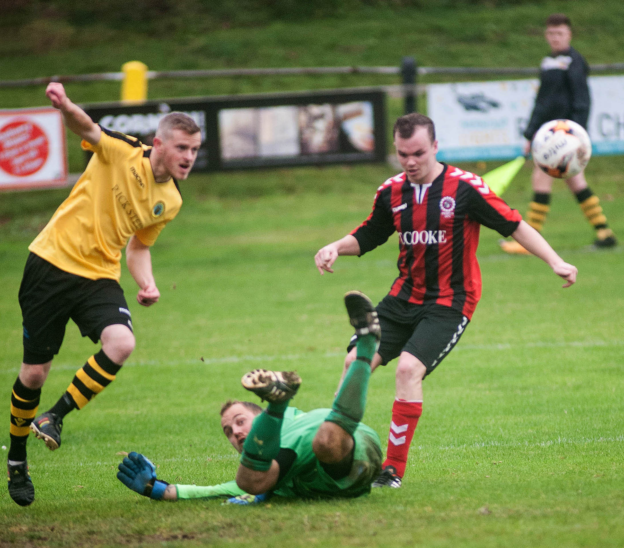 Porthleven's goalkeeper Scott Eastwood realises that the ball has been kept away from the net. Picture by Colin Higgs