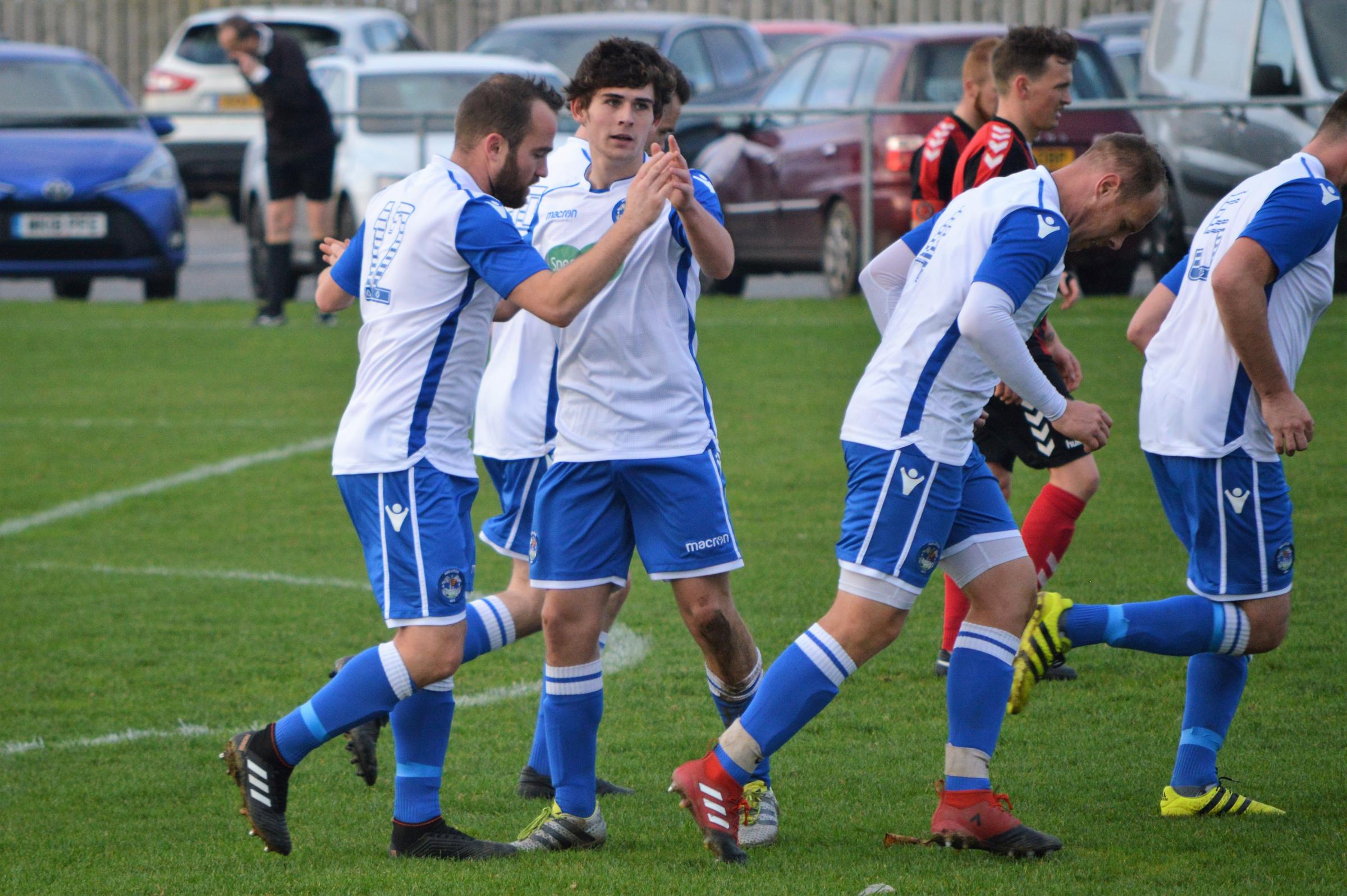 Helston's Jamie Thirkle (left) celebrates the second of his three goals in the 4-3 win at home to Penryn Athletic in the Combination League on Saturday