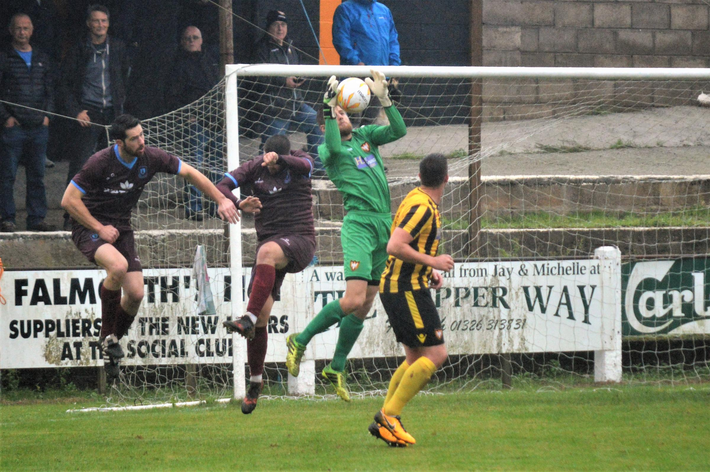 Falmouth Town goalkeeper Ryan Barnes (centre) kept a vital clean sheet at Exmouth Town on Saturday