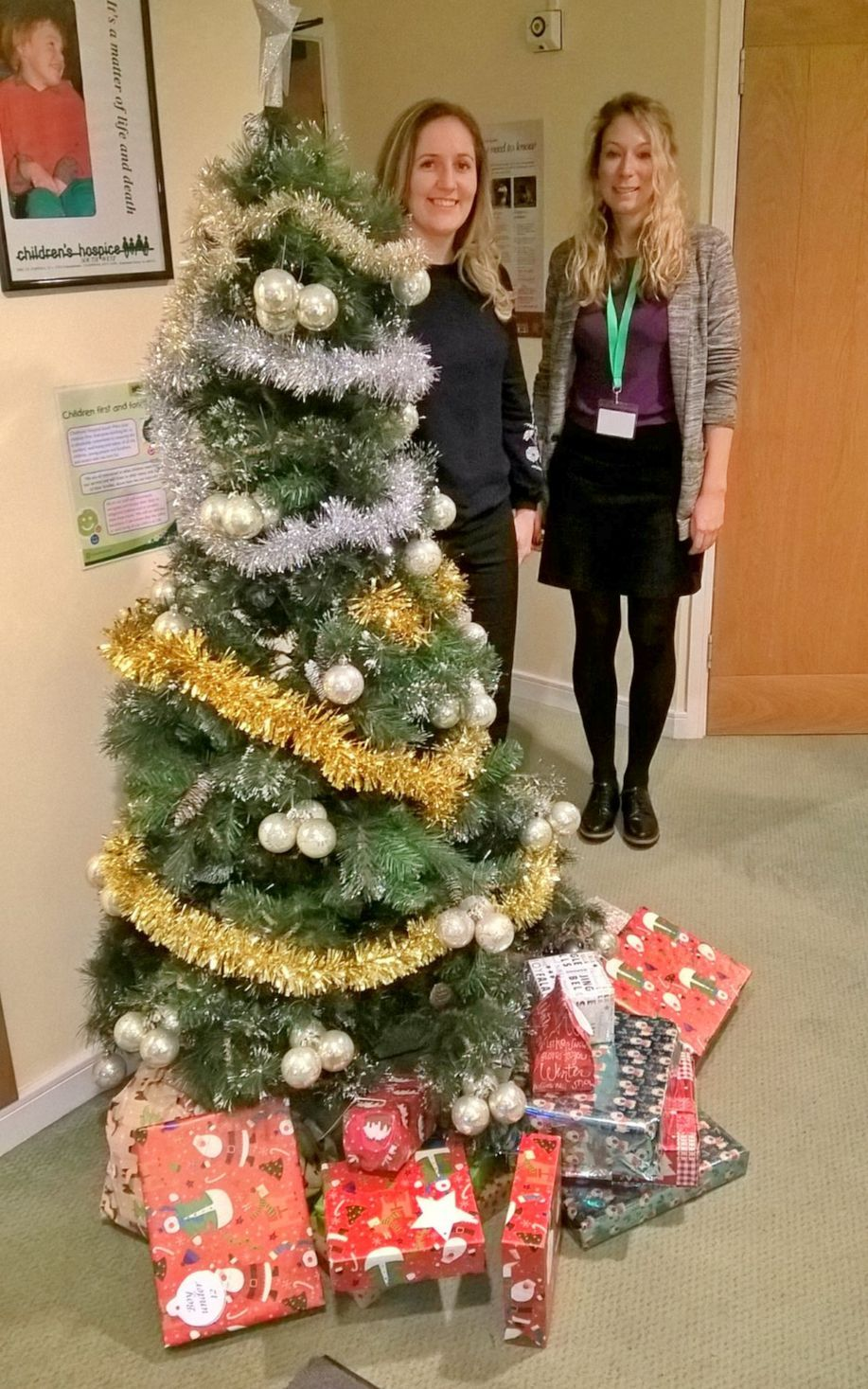 Emma Champion from RGB Building Supplies and Mhairi Bass-Carruthers, Children's Hospice South West corporate partnerships fundraiser, with some of the donated gifts