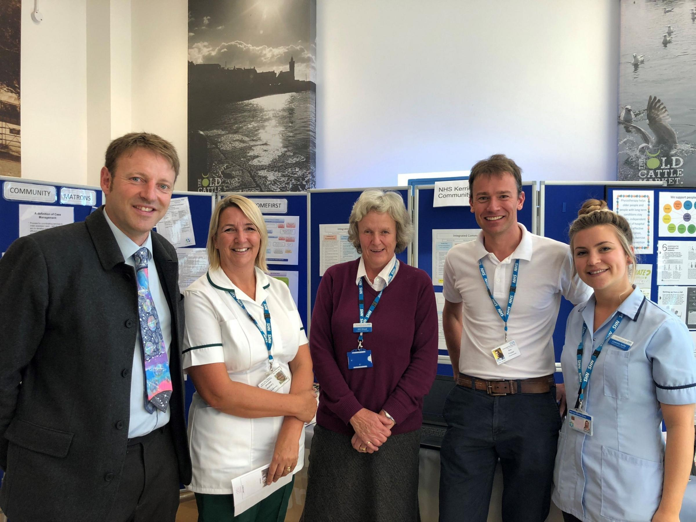 Derek Thomas meets NHS health professionals at a healthcare event in Helston