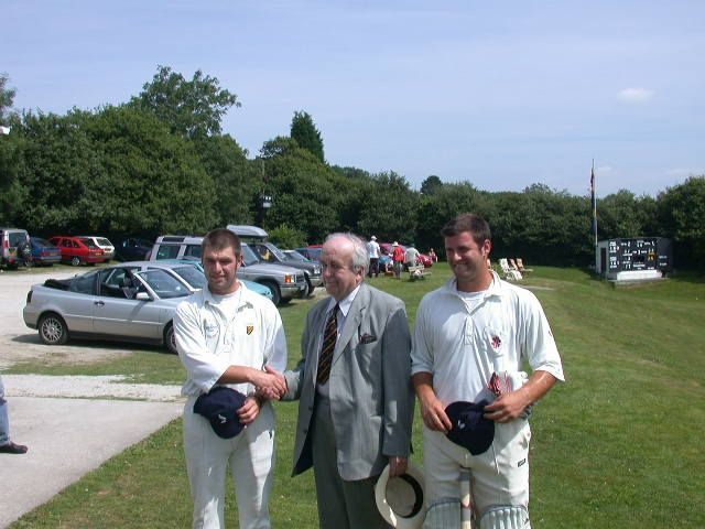 Julian Williams presents Gavin Edwards (left) and Tom Sharp with their Cornwall cricket caps in 2002