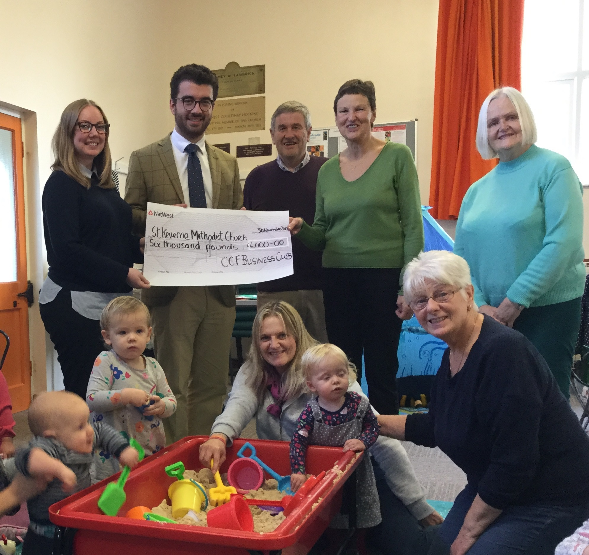 CCF Business Club members present Cheque to St Keverne Methodist Church and Little Blessings parent & toddler group. Left to right (standing): James Sculthorp-Wright and Jayne Robinson (both Atkins Ferrie Wealth Management) with Tony Ings (St Keverne