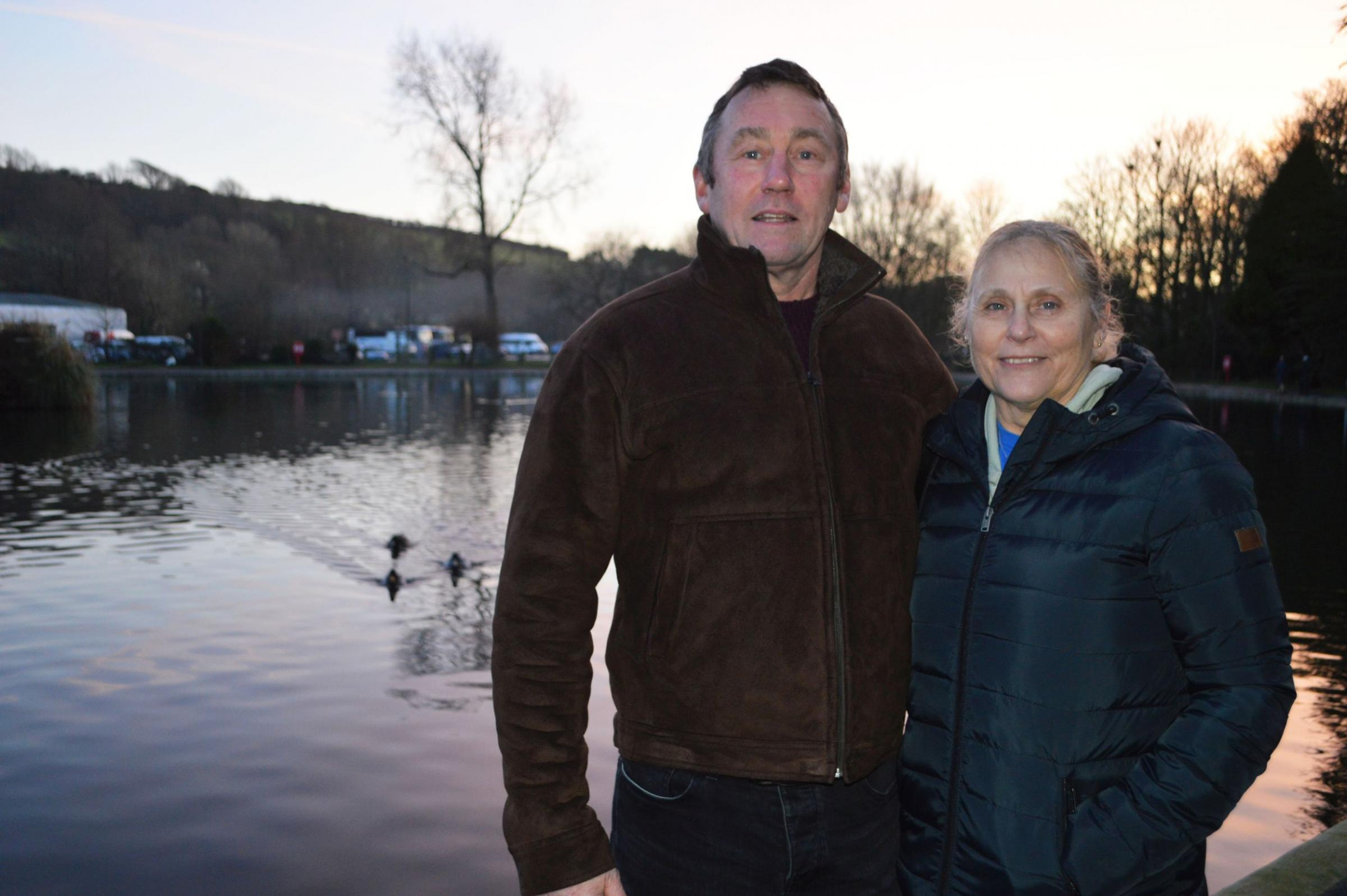 Alan Goldsworthy and Sue Mallinder at the spot where they pulled the woman from Helston Boating Lake