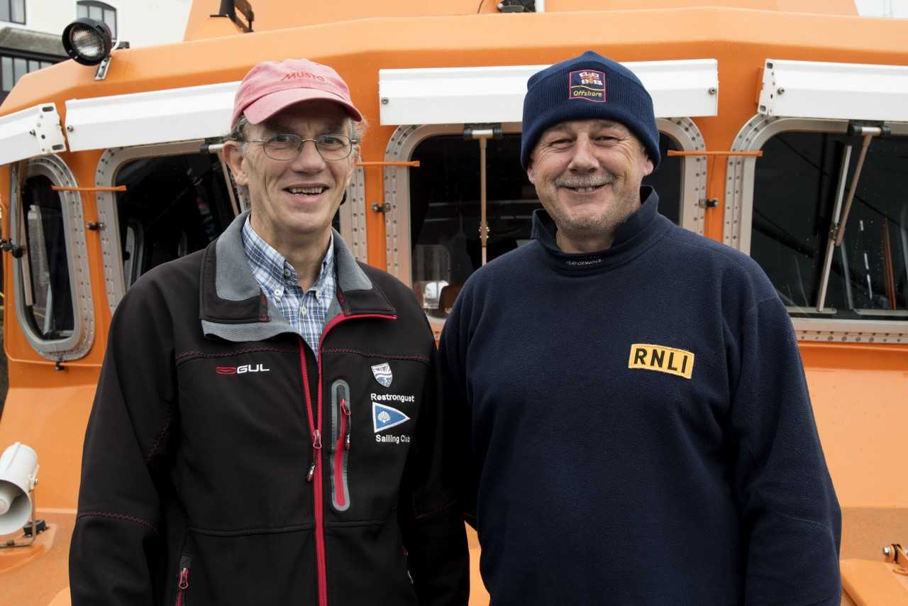 Henry Metcalfe, Restronguet Sailing Club Commodore with Falmouth RNLI Coxswain Jonathon Blakeston on board the station's Severn class all-weather lifeboat Richard Cox Scott. Credit: RNLI/Simon Culliford