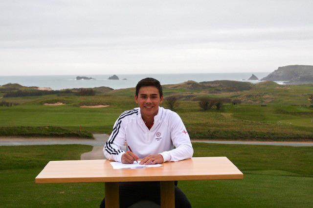 George Leigh signs his scholarship papers at his home course of Trevose