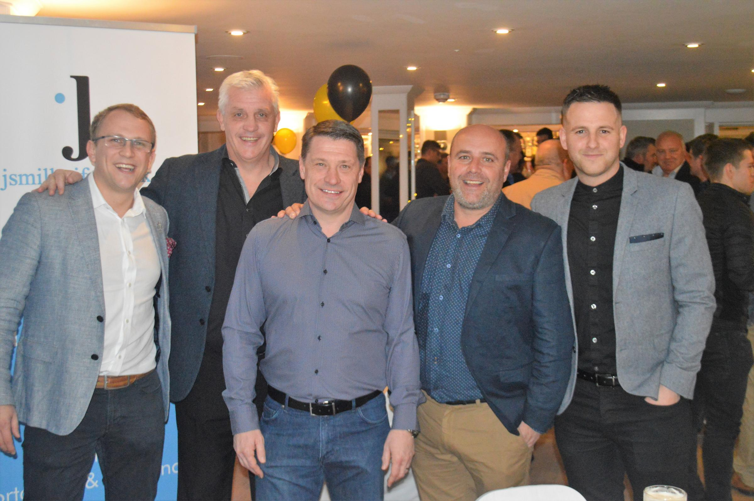 Falmouth Town manager Andrew Westgarth (far right) and assistant manager James Miller (far left), with former professional footballers Tony Gale (second from left) and Tony Cottee (centre)