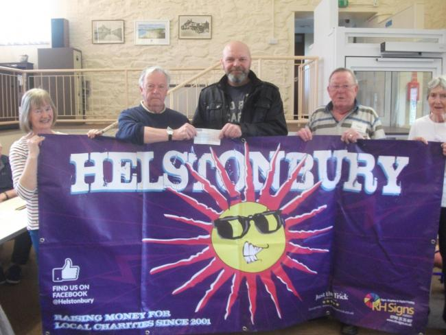 Chairman Mike Smith accepted a cheque from Helstonbury's Paul Turton