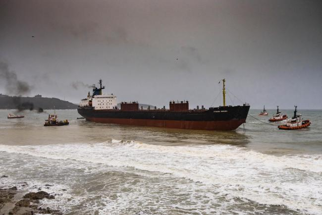 Tugs start to refloat the Kuzma Minin from Gyllyvase beach. Picture Mark Quilter